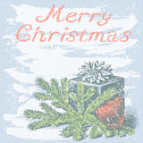 Chistmas present. Vector christmas card with a fir branch and a gift Stock Images