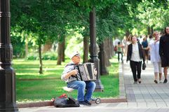 Chistoprudny Boulevard in Moscow, a street musician playing a musical instrument. stock photo