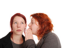Chit-chat. Woman gets a message whispered Stock Photos
