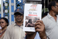 Chit Fund Book. Left activist selling a book on Chit Fund at Left organised rally protesting against Chit Fund and demanding the punishment for the accused stock photography