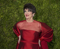 Chita Rivera Arrives at the 2015 Tony Awards. Legendary Broadway diva Chita Rivera in a bright red gown by Randi Rahm, arrives on the red carpet for the 69th Stock Images