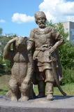 Chita, RU - Jul17 2014: Sulpture The Cossack and the Bear in Odori Park in the city of Chita, Transbaikalia edge Stock Image