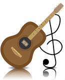 Chitarra acustica con una chiave tripla Immagine Stock Libera da Diritti