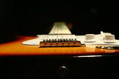 Chitarra elettrica d'annata su fondo nero Fotografia Stock Libera da Diritti