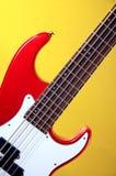 Chitarra elettrica rossa isolata su colore giallo Immagine Stock Libera da Diritti