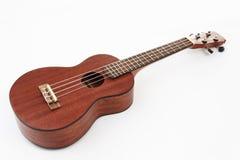 Chitarra hawaiana delle ukulele su fondo bianco immagine stock