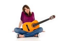 Chitarra teenager attraente della ragazza Immagine Stock