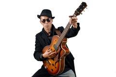 Chitarrista ed il suo strumento immagine stock libera da diritti
