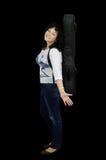 Chitarrista sorridente della donna che sta lateralmente Fotografie Stock