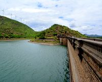 Chitradurga landscape. Here is a picture of the stunning view of chitradurga dam, the bridge leading the way and the windmills on top of the mountain enhances Royalty Free Stock Photos