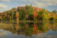 Chittenden Reservoir in the Fog. Chittenden Reservoir on a sunny autumn morning in Vermont stock photography