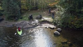 Chittenden, Vermont - 20181009 - Aerial Drone - man steps into kayak in lake in fall in Vermont stock video
