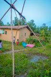 CHITWAN, NEPAL - NOVEMBER 03, 2017: Unidentified children playing near of wooden houses built in Chitwan, Nepal Royalty Free Stock Images