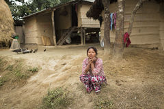 CHITWAN PARK, NEPAL - NOVEMBER 24: Woman of Nepal staying in the Royalty Free Stock Photo