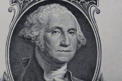 Chiuda fino al ritratto di George Washington su una banconota in dollari immagini stock