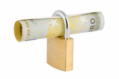 Chiuda i soldi a chiave Immagini Stock