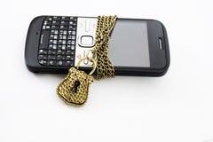 Chiuda il telefono a chiave Fotografia Stock