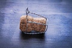 Chiuda su corck di champagne e di cavo a bordo Fotografia Stock Libera da Diritti