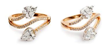Chiuda su degli anelli di diamante e di un oro Fotografia Stock Libera da Diritti