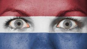 Chiuda su degli occhi con la bandiera Fotografie Stock Libere da Diritti