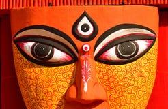 Chiuda su degli occhi di un idolo della dea indù Durga fotografie stock libere da diritti