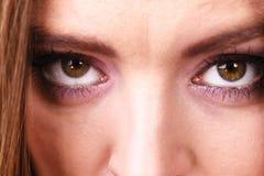 Chiuda su degli occhi femminili del fronte Fotografia Stock