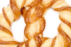 Chiuda su dei biscotti a forma di nodo. Fotografia Stock Libera da Diritti