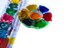 Chiuda su dei colori di manifesto variopinti con il fuoco selettivo Fotografie Stock