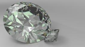 Chiuda su dei diamanti di una coppia su un fondo grigio Fotografia Stock Libera da Diritti