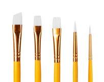 Chiuda su dei pennelli su fondo bianco Fotografie Stock Libere da Diritti