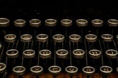 Chiuda in su dei tasti della macchina da scrivere fotografia stock