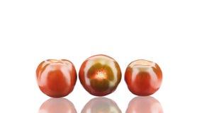 Chiuda su dei tre pomodori freschi Fotografia Stock