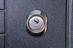 Chiuda su del buco della serratura in rotondo fissano il ferro Fotografie Stock Libere da Diritti
