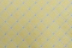 Fondo grafico giallo del tessuto Fotografie Stock