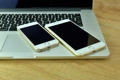 Chiuda su del iPhone 6s più, il iPhone 5s e ipad pro Immagini Stock