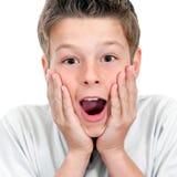 Chiuda in su del ragazzo con l'espressione sorprendente del fronte. Fotografia Stock Libera da Diritti