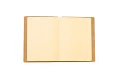 Chiuda su del taccuino marrone in bianco Immagini Stock