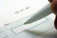 Chiuda in su dell'assegno in bianco Immagine Stock