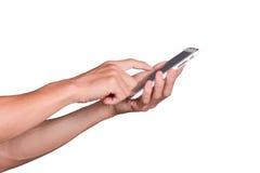 Chiuda su dell'uomo di affari che per mezzo dello Smart Phone mobile isolato su fondo bianco Fotografia Stock
