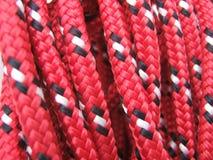 Chiuda su della corda rossa Fotografie Stock