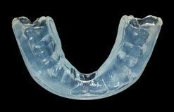 Chiuda su della guardia dei denti isolata fotografia stock libera da diritti