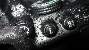Chiuda su della macchina fotografica bagnata Fotografie Stock