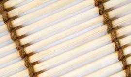 Chiuda in su della priorità bassa di bambù della stuoia Fotografia Stock