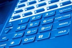 Chiuda in su della tastiera del telefono con la tonalità blu Fotografia Stock