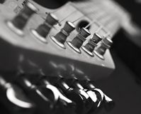 Chiuda in su della testa della macchina della chitarra Fotografia Stock