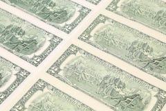 Chiuda su delle banconote in dollari. Fotografie Stock
