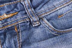 Chiuda su delle blue jeans fotografie stock