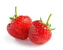 Chiuda su delle fragole dolci fresche su fondo bianco Fotografie Stock Libere da Diritti