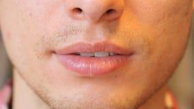 Chiuda su delle labbra dell'uomo Immagine Stock