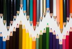 Chiuda su delle matite di colore con colore differente Immagini Stock Libere da Diritti